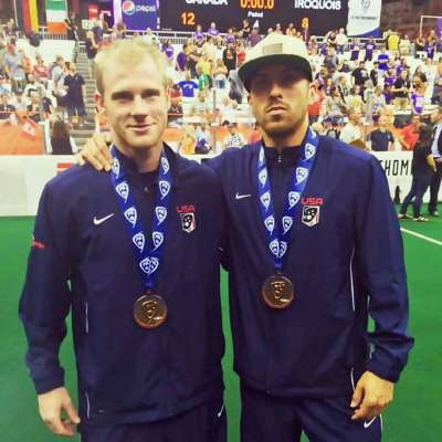Joe Walters poses with Knighthawks teammate after winning bronze medal
