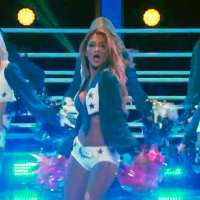 Nicole Scherzinger performs with the Dallas Cowboys Cheerleaders
