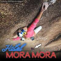 Sasha DiGiulian climbing high above the Hotel Mora Mora in Madagascar