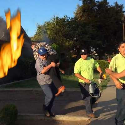 Dodgers fan and Yankees fan team up on fire rescue