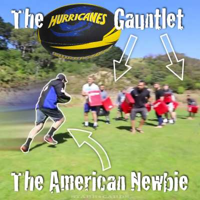 Elton Castee of TFIL runs the gauntlet formed by Wellington Hurricanes rugby players