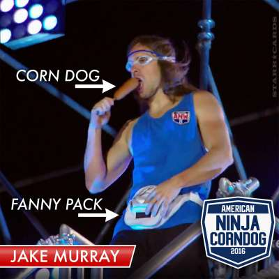 Jake Murray takes a bite from a corn dog on 'American Ninja Warrior'