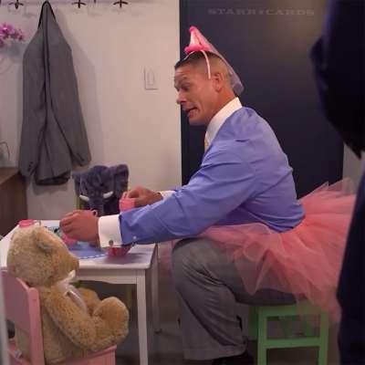 John Cena serving tea in a tutu