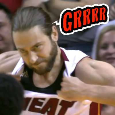 Miami Heat power forward Josh McRoberts tears his jersey