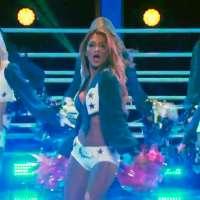 Nicole Scherzinger performs with the Dallas Cowboys Cheerleaders