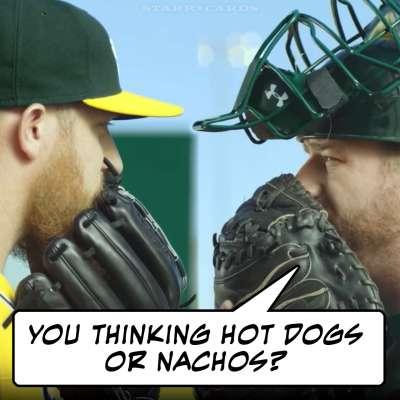 Oakland Athletics catcher Stephen Vogt and Pitcher Sean Doolittle consult on the mound