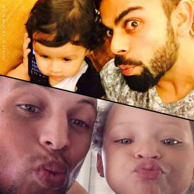 Virat Kohli posing with Zina Dhoni and Steph Curry posing with Riley Curry