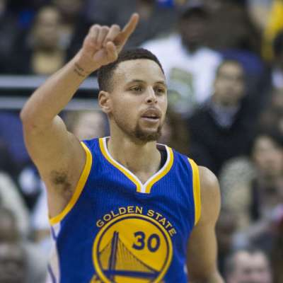 Warriors Steph Curry dribbles ball up court